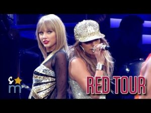 "Video thumbnail for youtube video Taylor Swift e Jennifer Lopez cantano ""Jenny from The block"" al Red Tour"
