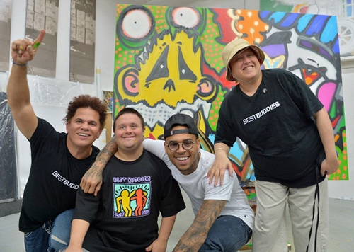 MIAMI, FL - MARCH 27: (EXCLUSIVE ACCESS) Romero Britto, Chris Gay, Chris Brown and Samiha Dossus attend the Chris Brown joins forces with artist Romero Britto in support of Best Buddies International event on March 27, 2013 in Miami, Florida. (Photo by Gustavo Caballero/Getty Images)