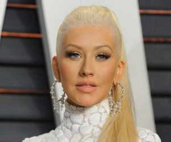 christina-aguilera-does-spot-on-impersonation-of-britney-spears-cher-and-shakira-300x387