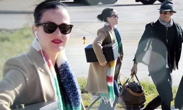 04.March.2016 - London - UK ***EXCLUSIVE PICTURES*** Hot new couple Orlando Bloom and Katy Perry arrive in London after spending some time together in New York.  They were in Heathrow for 4 hours before they left for Luton Airport, where it seemed they met up with many friends who all got on a private jet to a mystery destination for what appeared to be a wedding, as many of the guests were carrying suit bags.  All of the guests were photographed getting on the plane except Orlando and Katy, maybe as they were not in the best of appearances after their long journey.  The couple however seemed happy and in good spirits, they were laughing and joking with each other and their friends as they jumped on the private jet.  It all seemed a very happy atmosphere for the new loved up couple ! BYLINE MUST READ : D. TAYLOR - NASH / XPOSUREPHOTOS.COM ***UK CLIENTS - PICTURES CONTAINING CHILDREN PLEASE PIXELATE FACE PRIOR TO PUBLICATION*** *UK CLIENTS MUST CALL PRIOR TO TV OR ONLINE USAGE PLEASE TELEPHONE 0208 344 2007*