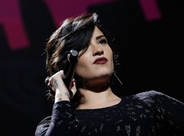 demi-lovato-cross-tattoo-hand