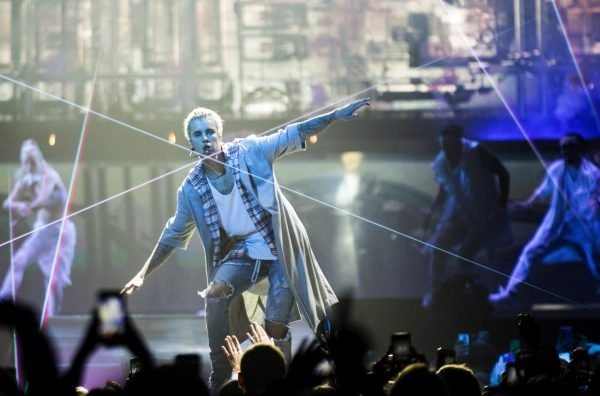 Justin Bieber puts his arms out as he dances and lasers flit across the stage during the opening of his Purpose World Tour at KeyArena on Wednesday, March 9, 2016. Bieber's North American leg of the tour continues through the summer, ending at Madison Square Garden in New York City. (Lindsey Wasson / The Seattle Times)