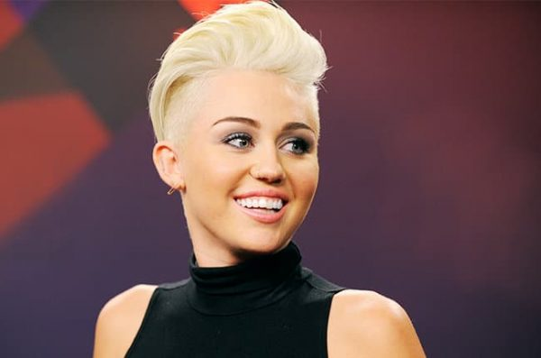 LAS VEGAS, NV - SEPTEMBER 21: Singer Miley Cyrus poses in the Elvis Duran Broadcast Room during the 2012 iHeartRadio Music Festival at the MGM Grand Garden Arena on September 21, 2012 in Las Vegas, Nevada. (Photo by David Becker/Getty Images for Clear Channel)