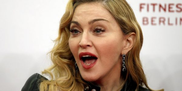 """U.S. pop star Madonna speaks during her visit at the """"Hard Candy Fitness"""" center in Berlin, Germany, Thursday, Oct. 17, 2013. (AP Photo/Michael Sohn)"""