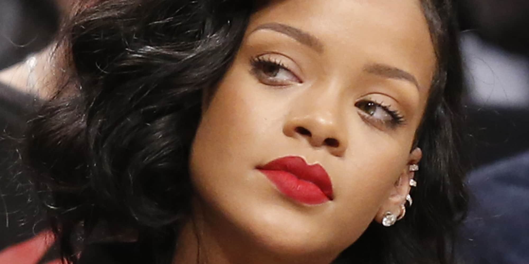 Singer Rihanna watches the first half of the Brooklyn Nets as they faced the Atlanta Hawks in an NBA basketball game at the Barclays Center, Monday, Jan. 6, 2014, in New York. (AP Photo/Kathy Willens)