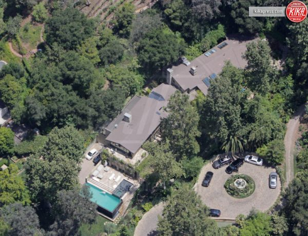 154119, Jennifer Lopez splashed out $28 million for actress Sela Ward's estate in Bel Air. The extravagant home sits on 8 acres of lush ground featuring waterfalls and koi ponds, an infinity pool, and walking paths and trails into the hills. The property features 7 bedrooms, 13 bathrooms, and 10 fireplaces. Ward and her husband, Howard Sherman, were said to have elegantly decorated the home with fixtures from around the globe. Lopez has reportedly sold her former residence in Hidden Hills for $17 million. Bel Air, California - Friday June 24, 2016. Photograph: © CelebrityHomePhotos. Los Angeles Office (PCN): +1 310.822.0419 UK Office (Photoshot): +44 (0) 20 7421 6000 sales@pacificcoastnews.com FEE MUST BE AGREED PRIOR TO USAGE