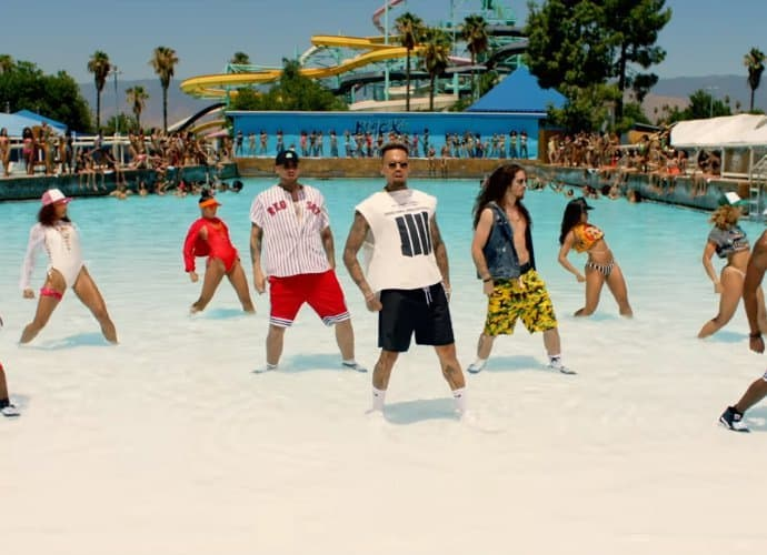 chris brown hits water park for epic pool party in pills and automobiles